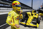 Helio Castroneves, of Brazil, take off his helmet during practice for the Indianapolis 500 IndyCar auto race at Indianapolis Motor Speedway, Tuesday, May 14, 2019, in Indianapolis. (AP Photo/Darron Cummings)