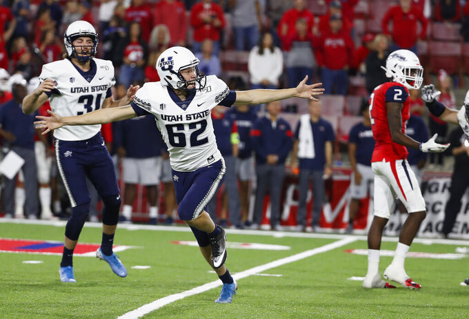 Utah State's Dominik Eberle watches his game-winning field goal against Fresno State during an NCAA college football game in Fresno, Calif., Saturday, Nov. 9, 2019. (AP Photo/Gary Kazanjian)