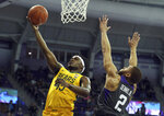 Baylor guard Davion Mitchell (45) puts up a shot against TCU guard Edric Dennis (2) in during the first half of an NCAA college basketball game on Saturday, Feb. 29, 2020 in Fort Worth, Texas. (AP Photo/Richard W. Rodriguez)