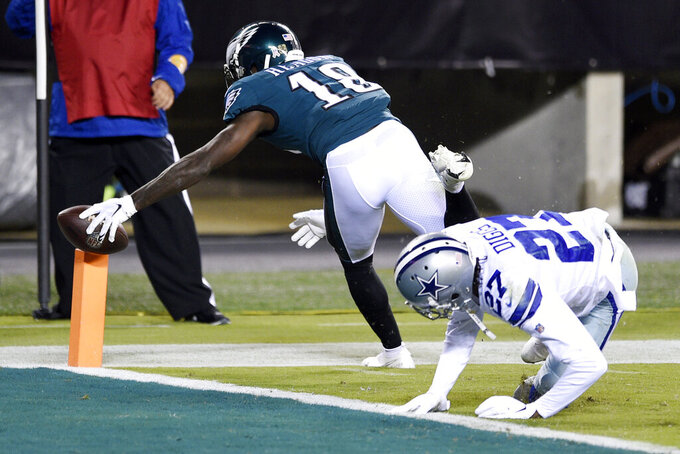 Philadelphia Eagles' Jalen Reagor (18) scores a touchdown against Dallas Cowboys' Trevon Diggs (27) during the first half of an NFL football game, Sunday, Nov. 1, 2020, in Philadelphia. (AP Photo/Derik Hamilton)