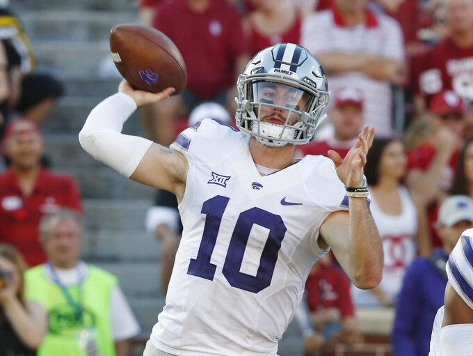 FILE - In this Oct. 27, 2018, file photo, Kansas State quarterback Skylar Thompson (10) throws in the second of an NCAA college football game against Oklahoma in Norman, Okla. Skylar Thompson went through the ringer his first two seasons in Manhattan, never quite feeling confident of himself under longtime coach Bill Snyder. But with the arrival of Chris Klieman, the junior signal-caller has taken over the leadership of a team that has bowl expectations under its new head coach. (AP Photo/Sue Ogrocki, File)