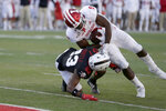 Indiana running back Stevie Scott III (8) scores a two-point conversion against Nebraska cornerback Dicaprio Bootle (23) during the second half of an NCAA college football game in Lincoln, Neb., Saturday, Oct. 26, 2019. Indiana won 38-31. (AP Photo/Nati Harnik)