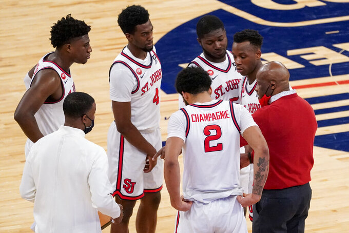 St. John's head coach Mike Anderson, right, gives his team instruction during the second half of an NCAA college basketball game against Seton Hall in the quarterfinals of the Big East conference tournament, Thursday, March 11, 2021, in New York. (AP Photo/Mary Altaffer)