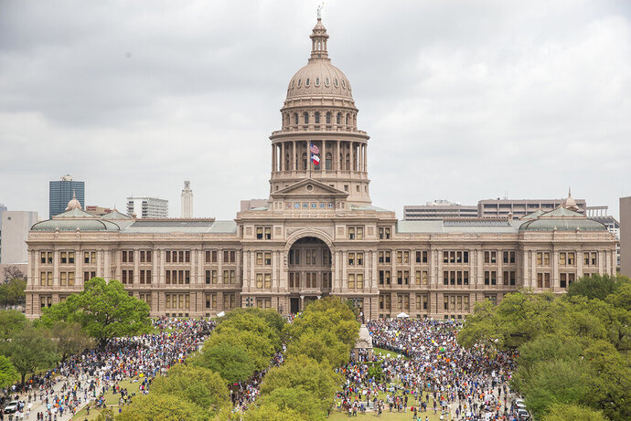 FILE - In this March 24, 2018, file photo, thousands of people gather on the grounds of the Texas State Capitol during a