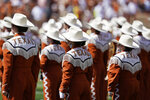 """In this Saturday, Sept. 4, 2021, file photo, the Texas band take the field to perform before an NCAA college football between Texas and Louisiana-Lafayette in Austin, Texas.  The Texas chapter of the NAACP and a group of UT students have filed a federal civil rights complaint against the University of Texas for its continued use of """"The Eyes of Texas"""" school song, tune with racist elements in its past. The complaint filed Friday, Sept. 3, 2021, with the U.S. Department of Education alleges that Black students and faculty are being subjected to violations of the Civil Rights Act and a hostile campus environment. (AP Photo/Eric Gay)"""