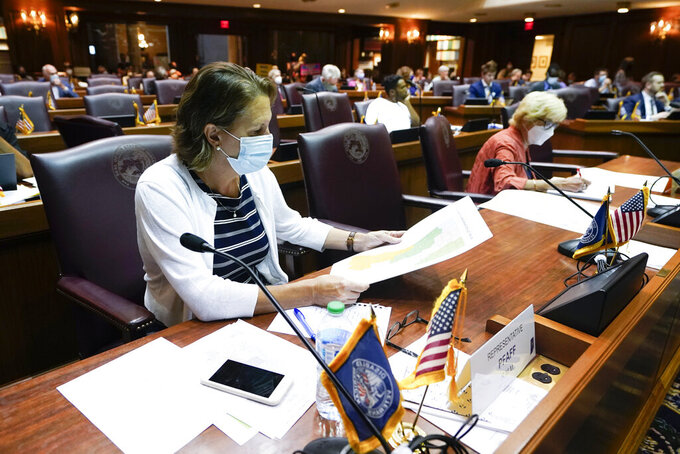 Rep. Tonya Pfaff listens during a public hearing on the redistricting plan at the Statehouse, Thursday, Sept. 16, 2021, in Indianapolis. (AP Photo/Darron Cummings)