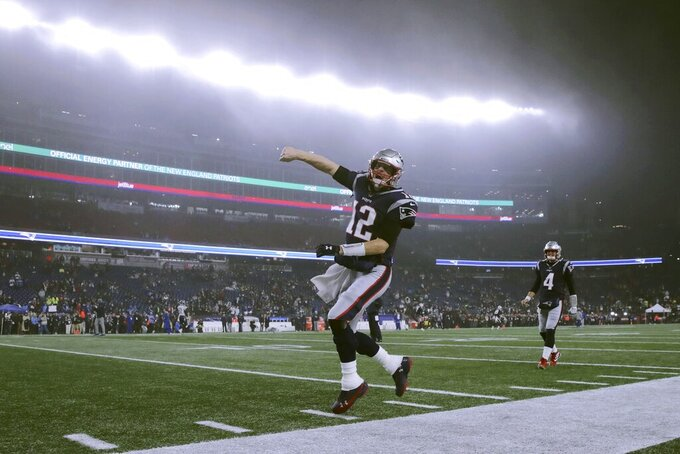 New England Patriots quarterback Tom Brady charges onto the field for an NFL wild-card playoff football game against the Tennessee Titans, Saturday, Jan. 4, 2020, in Foxborough, Mass. (AP Photo/Charles Krupa