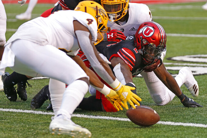 Arizona State defensive back Evan Fields (4) picks up the fumble from Utah running back Zack Moss (2) during the first half of an NCAA college football game Saturday, Oct. 19, 2019, in Salt Lake City. (AP Photo/Rick Bowmer)