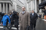 Joseph Percoco, center, a former top aide to New York Gov. Andrew Cuomo, leaves U.S. District court, Tuesday, March 13, 2018, in New York. Percoco was convicted on corruption charges Tuesday at a trial that further exposed the state capital's culture of backroom deal-making. (AP Photo/Mary Altaffer)