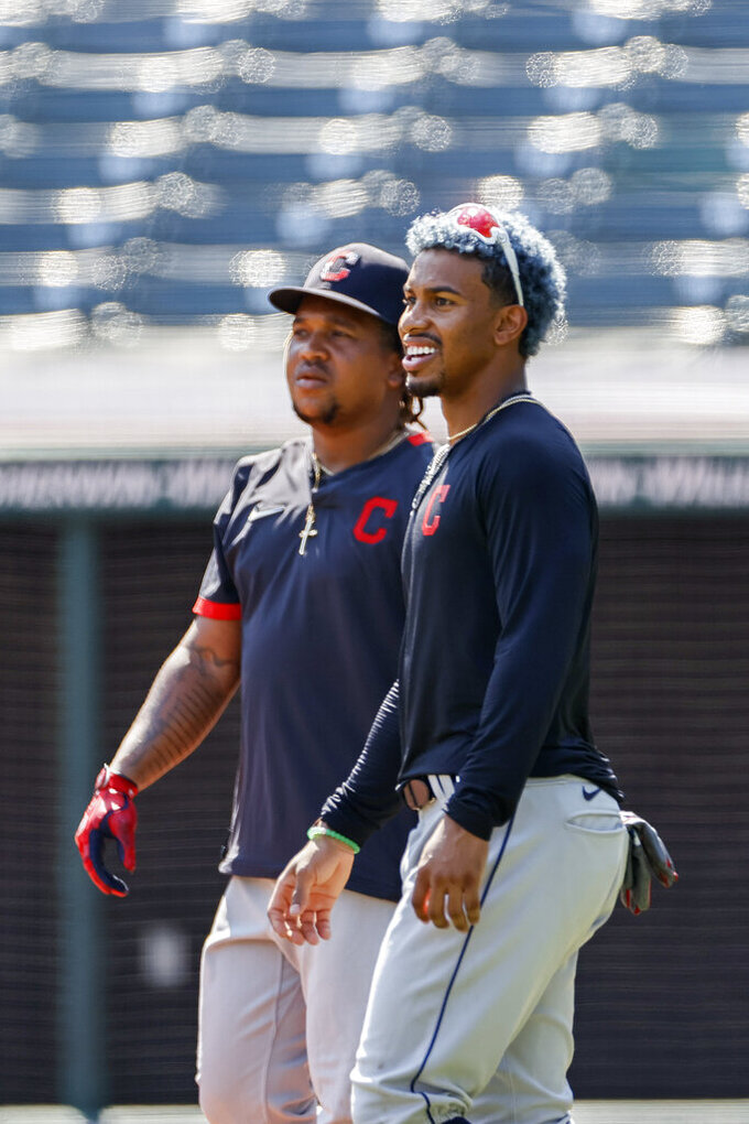 Cleveland Indians' Francisco Lindor, right, and Jose Ramirez watch batting practice during baseball practice at Progressive Field, Monday, July 6, 2020, in Cleveland. (AP Photo/Ron Schwane)
