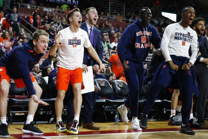 The Syracuse bench reacts during the second half of an NCAA college basketball game against Boston College, Tuesday, March, 3, 2020, in Boston. (AP Photo/Michael Dwyer)