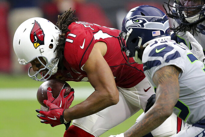 Arizona Cardinals wide receiver Larry Fitzgerald (11) catches his career 1,325 catch to tie Tony Gonzalez for second place on the all-time receptions list during the second half of an NFL football game against the Seattle Seahawks, Sunday, Sept. 29, 2019, in Glendale, Ariz. (AP Photo/Ross D. Franklin)