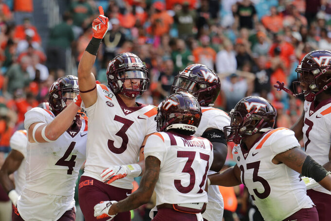 Hokies waste huge lead, then rally to top Miami 42-35