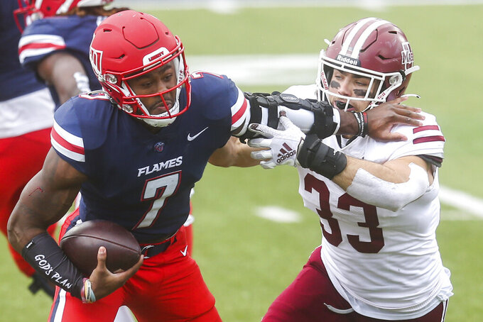 Liberty quarterback Malik Willis (7) carries the ball during the first half of a NCAA college football game against Massachusetts on Friday, Nov. 27, 2020, at Williams Stadium in Lynchburg, Va. (AP Photo/Shaban Athuman)
