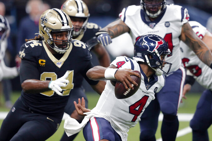 New Orleans Saints defensive end Cameron Jordan (94) pursues Houston Texans quarterback Deshaun Watson (4) in the first half of an NFL football game in New Orleans, Monday, Sept. 9, 2019. (AP Photo/Bill Feig)