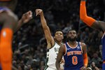 Milwaukee Bucks' Giannis Antetokounmpo shoots a three-point basket during the second half of an NBA basketball game against the New York Knicks Tuesday, Jan. 14, 2020, in Milwaukee. (AP Photo/Morry Gash)