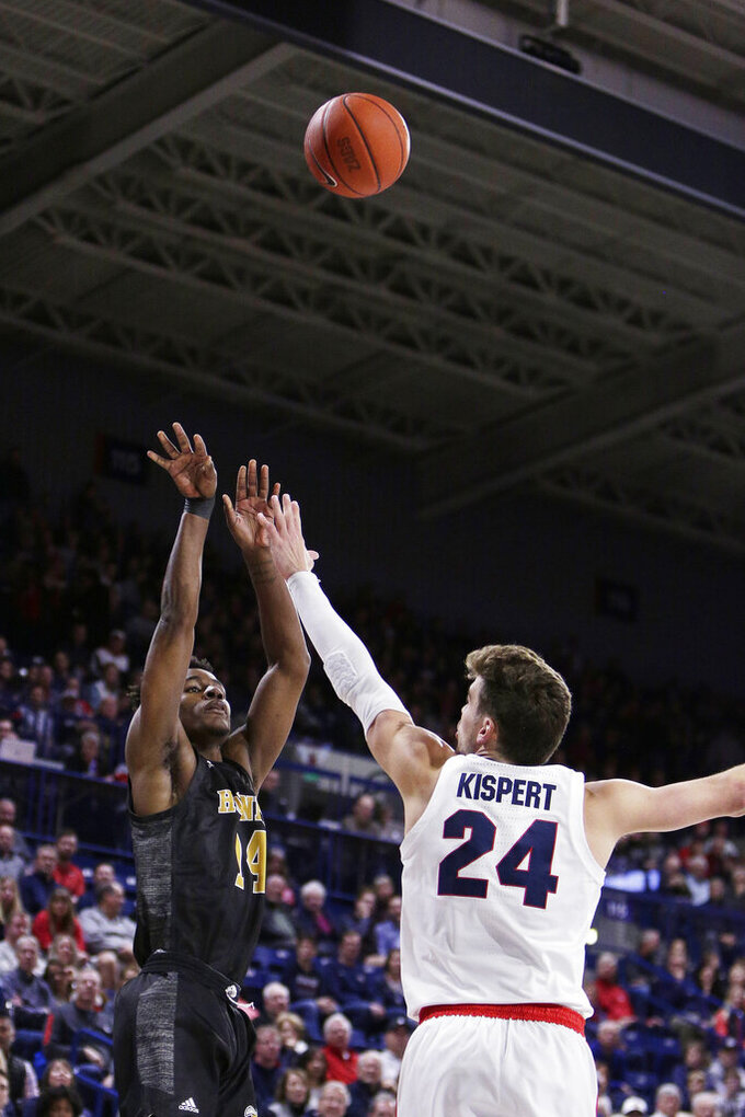 Alabama State forward Brandon Battle, left, shoots over Gonzaga forward Corey Kispert during the first half of an NCAA college basketball game in Spokane, Wash., Tuesday, Nov. 5, 2019. (AP Photo/Young Kwak)
