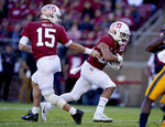 Stanford quarterback Davis Mills (15) hands off to running back Cameron Scarlett (22) for a touchdown against California during the second half of an NCAA college football game Saturday, Nov. 23, 2019 in Stanford, Calif. (AP Photo/Tony Avelar)