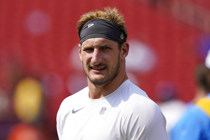 Los Angeles Chargers defensive end Joey Bosa (97) during pregame warmups prior to the start of the first half of an NFL football game against the Washington Football Team, Sunday, Sept. 12, 2021, in Landover, Md. (AP Photo/Alex Brandon)