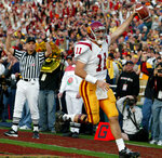 FILE - In this Jan. 1, 2004, file photo, Southern California quarterback Matt Leinart scores during the third quarter on a 15-yard pass completion thrown by USC wide receiver Mike Williams against Michigan in the 90th Rose Bowl in Pasadena, Calif. At the start of the play, Leinart tossed a lateral pass to White. USC set a record by going 33 straight polls as No. 1 from 2003-05. The Trojans weren't just the best team in college football, they were also arguably the coolest, with the charismatic, laid-back Carroll leading stars like quarterback Matt Leinart and running back Reggie Bush to victory after victory. (AP Photo/Nam Y. Huh, File)