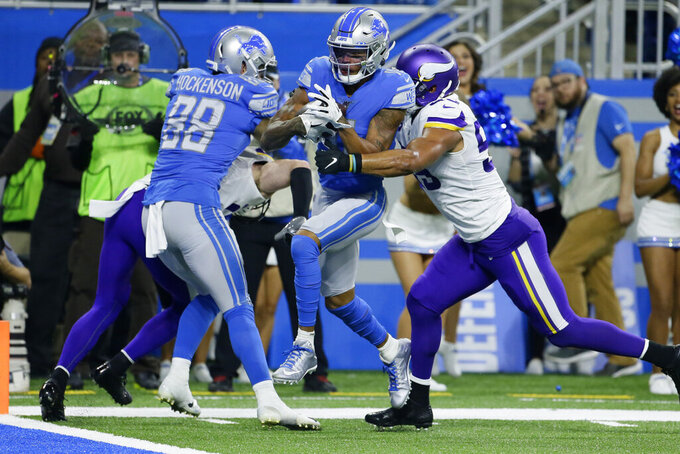 Detroit Lions wide receiver Marvin Jones (11) pulls ahead of Minnesota Vikings outside linebacker Anthony Barr (55) to score a touchdown during the first half of an NFL football game, Sunday, Oct. 20, 2019, in Detroit. (AP Photo/Duane Burleson)