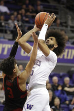 Washington's Marcus Tsohonis shoots over Stanford's Tyrell Terry (3) during the first half of an NCAA college basketball game Thursday, Feb. 20, 2020, in Seattle. (AP Photo/Elaine Thompson)