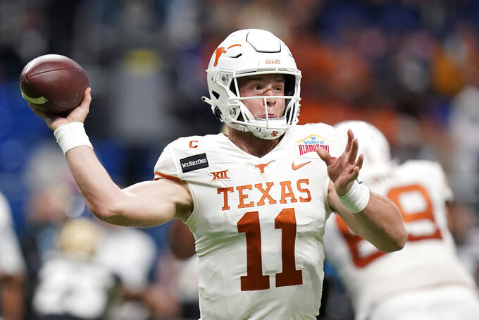 Texas quarterback Sam Ehlinger (11) throws a pass against Colorado during the first half of the Alamo Bowl NCAA college football game Tuesday, Dec. 29, 2020, in San Antonio. (AP Photo/Eric Gay)