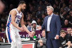 Philadelphia 76ers guard Ben Simmons (25) talks to head coach Brett Brown during the first half of an NBA basketball game against the Brooklyn Nets, Monday, Jan. 20, 2020, in New York. (AP Photo/Mary Altaffer)