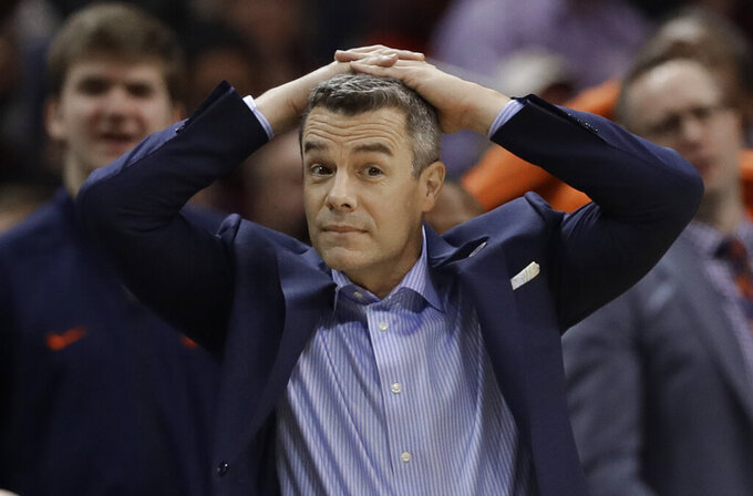 Virginia head coach Tony Bennett reacts to a call during the second half of an NCAA college basketball game against North Carolina State in the Atlantic Coast Conference tournament in Charlotte, N.C., Thursday, March 14, 2019. (AP Photo/Chuck Burton)
