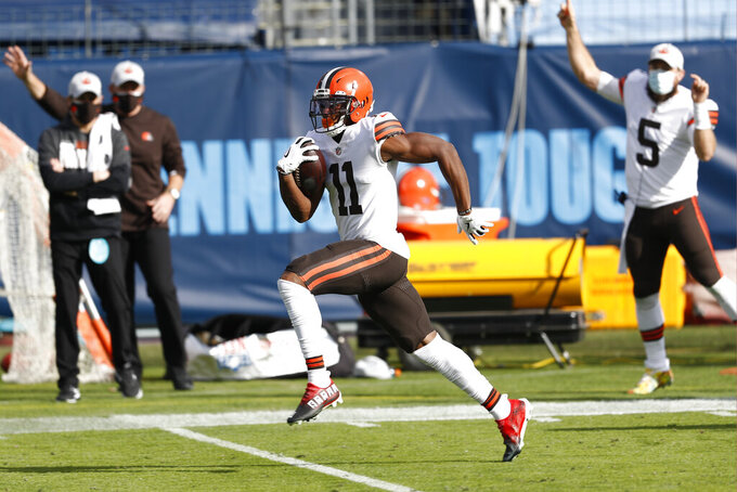 Cleveland Browns wide receiver Donovan Peoples-Jones (11) runs down the field for a touchdown on a 75-yard pass play against the Tennessee Titans in the first half of an NFL football game Sunday, Dec. 6, 2020, in Nashville, Tenn. (AP Photo/Wade Payne)