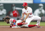 Philadelphia Phillies' Odubel Herrera arrives at second with a double as St. Louis Cardinals shortstop Paul DeJong (12) applies the late tag during the second inning of a baseball game, Tuesday, May 7, 2019, in St. Louis. (AP Photo/Tom Gannam)