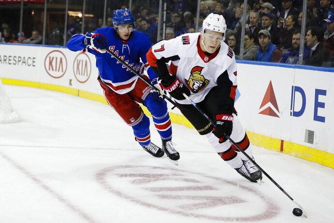 New York Rangers' Libor Hajek (25) chases Ottawa Senators' Brady Tkachuk (7) during the first period of an NHL hockey game Monday, Nov. 4, 2019, in New York. (AP Photo/Frank Franklin II)