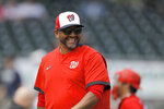 FILE - In this March 10, 2020, file photo, Washington Nationals manager Dave Martinez reacts while walking back to the dugout after pulling starting pitcher pitcher Ben Braymer during the third inning of a spring training baseball game against the Miami Marlins in Jupiter, Fla.
