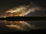 FILE -- In this Wednesday, Nov. 28, 2018 file photo clouds of smoke are pictured over Europe's largest lignite power plant in Belchatow, central Poland. (AP Photo/Czarek Sokolowski, file)