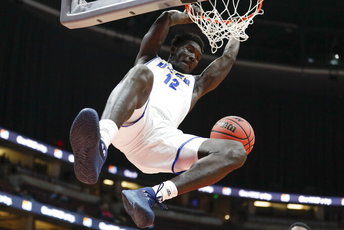 UC Santa Barbara forward Amadou Sow dunks against Cal State Northridge during the first half of a NCAA college basketball game at the Big West men's tournament in Anaheim, Calif., Thursday, March 14, 2019. (AP Photo/Chris Carlson)