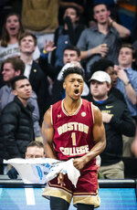 Boston College forward Jairus Hamilton (1) celebrates a late game basket by Ky Bowman during an NCAA college basketball game against Wake Forest, Saturday, Jan. 26, 2019, in Winston-Salem, N.C. (Andrew Dye/The Winston-Salem Journal via AP)