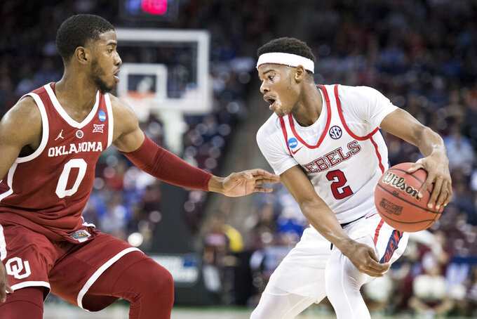 Mississippi guard Devontae Shuler (2) dribbles the ball against Oklahoma guard Christian James (0) during a first-round game in the NCAA men's college basketball tournament Friday, March 22, 2019, in Columbia, S.C. Oklahoma defeated Mississippi 95-72. (AP Photo/Sean Rayford)