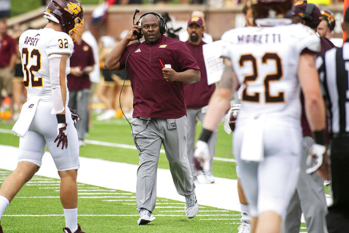 Central Michigan assistant head coach Tim Skipper, center, runs on the field during a timeout during the first half of an NCAA college football game against Missouri, Saturday, Sept. 4, 2021, in Columbia, Mo. Skipper is replacing head coach Jim McElwain who did not make the trip. (AP Photo/L.G. Patterson)