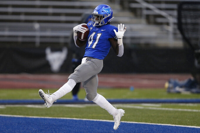 Buffalo's  Kevin Marks Jr. scores a touchdown during the first half of an NCAA college football game against Akron in Amherst, N.Y., Saturday, Dec. 12, 2020. (AP Photo/Jeffrey T. Barnes)