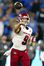 Fresno State quarterback Jake Haener throws during the second half of an NCAA college football game against UCLA Sunday, Sept. 19, 2021, in Pasadena, Calif. (AP Photo/Marcio Jose Sanchez)