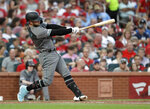Arizona Diamondbacks' Christian Walker follows through on a solo home run during the fourth inning of the team's baseball game against the St. Louis Cardinals on Friday, July 12, 2019, in St. Louis. (AP Photo/Jeff Roberson)