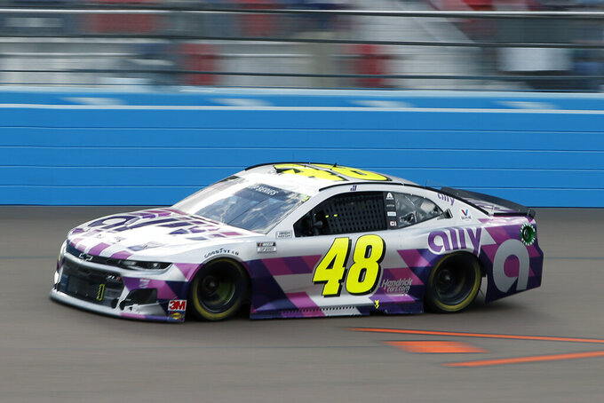 Jimmie Johnson (48) races through Turn 4 during the NASCAR Cup Series auto race at Phoenix Raceway, Sunday, Nov. 8, 2020, in Avondale, Ariz. (AP Photo/Ralph Freso)