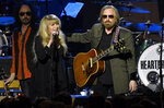"FILE - Stevie Nicks, left, and honoree Tom Petty perform at the MusiCares Person of the Year tribute in Los Angeles on Feb. 10, 2017.  Just months before Petty died, the pair got together at the British Summer Time at Hyde Park in London to perform their 1981 hit ""Stop Draggin' My Heart Around.""  (Photo by Chris Pizzello/Invision/AP, File)"