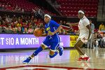 Delaware guard Tee Johnson, left, pushes toward the basket during the first half of an NCAA college basketball game against Maryland, Sunday, Nov. 17, 2019, in College Park, Md. (AP Photo/Brien Aho)