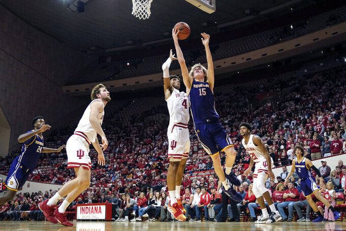 Western Illinois forward Ben Pyle (15) shoots in front of Indiana forward Trayce Jackson-Davis (4) in the second half of an NCAA college basketball game in Bloomington, Ind., Tuesday, Nov. 5, 2019. Indiana won 98-65. (AP Photo/AJ Mast)