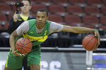 Oregon's Louis King dribbles during practice for the NCAA men's college basketball tournament, Wednesday, March 27, 2019, in Louisville, Ky. (AP Photo/Darron Cummings)