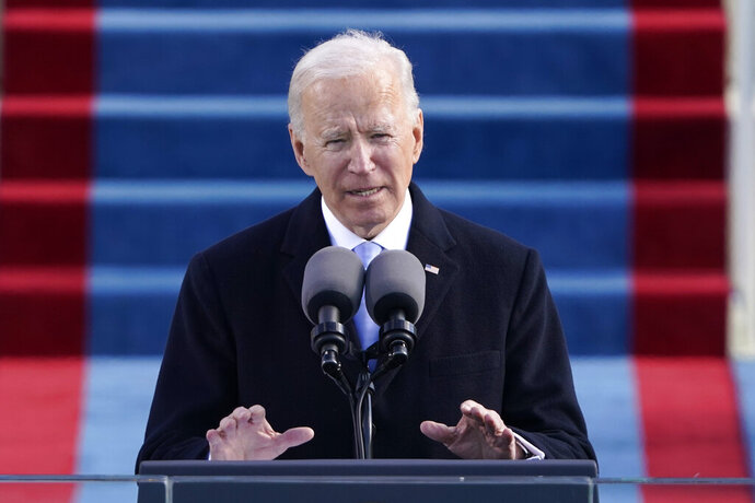 """FILE - In this Wednesday, Jan. 20, 2021 file photo, President Joe Biden speaks during the 59th Presidential Inauguration at the U.S. Capitol in Washington. he Biden administration is taking quick steps to keep the United States in the World Health Organization, part of his ambition to launch a full-throttle effort to fight the COVID-19 pandemic. Just hours before Wednesday's inauguration, the Biden-Harris transition team announced its plans to """"take action"""" to halt a U.S. withdrawal begun under Trump and work with partners to reform WHO and support its response to the coronavirus outbreak.  (AP Photo/Patrick Semansky, file)"""