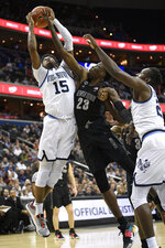 Georgetown forward Josh LeBlanc, center, battles for the ball against Villanova forward Saddiq Bey, left, and forward Dhamir Cosby-Roundtree, right, during the first half of an NCAA college basketball game, Wednesday, Feb. 20, 2019, in Washington. LeBlanc was called for a foul on the play. (AP Photo/Nick Wass)