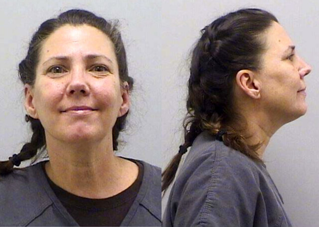 This undated booking photo provided by the Douglas County Sheriff's Office, in Colorado, shows Cynthia Abcug. Abcug, accused of working with supporters of QAnon to have her son kidnapped from foster care, can be put on trial, a judge ruled Thursday, Aug. 13, 2020. (Douglas County Sheriff's Office via AP)
