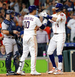 Houston Astros third baseman Yuli Gurriel (10) and Carlos Correa (1) celebrate Correa's home run during the fifth inning of a baseball game against the New York Yankees Wednesday, April 10, 2019, in Houston. (AP Photo/Michael Wyke)